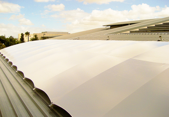 An image of a white shade on a Triax System.
